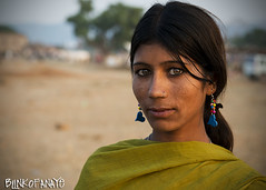 Mamta (Blinkofanaye) Tags: sunset portrait woman india green girl animal festival eyes fair earrings pushkar rajasthan ajmer 2013