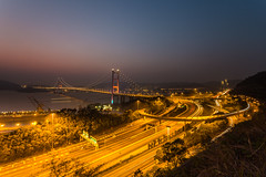 Tsing(ing) in the Smog (Daniel Borg) Tags: china camera longexposure bridge blue light red orange sun lines yellow fog skyline night sunrise canon landscape hongkong gold lights vanishingpoint other asia long colours pov smooth wideangle calm abroad nd lighttrails bluehour fullframe suspensionbridge 1740 goldenhour newterritories 6d countrypark uwa tsingmabridge canon1740l ultrawideangle neutraldensity danielborg leefilters canon6d 09nd 09hardgrad vision:mountain=082 vision:sunset=0778 vision:outdoor=099 vision:clouds=099 vision:sky=099