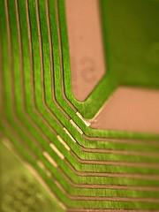 Metallic Macro (fstop186) Tags: macro green alarm metal mystery shiny bokeh metallic object rfid tag surreal security panasonic glossy g3 stealing diagonals antitheft mft microfourthirds micro43rds panasonicdmcg3