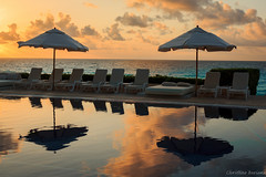 tranquil reflections (christinebiondi) Tags: beach pool sunrise reflections mexico cancun umbrellas