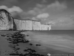 Beach and Arch (SarahO44) Tags: uk sea bw white black beach rock clouds canon bay chalk kent sand arch slow united kingdom lee shutter stacks 6d kingsgate leebigstopper