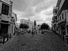 Divergence (Petr Horak) Tags: 2016 family holiday rethymno crete greece grc street bw architecture europe omd wideangle building city pavement