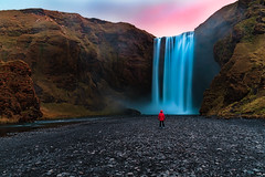Pink sky, crystal blue water, mountains and rocks. What else do we need? (Matthias Dengler || www.snapshopped.com) Tags: skogafoss iceland waterfall sunset sunrise travel adventure outdoor landscape matthias dengler snapshopped sky island islandia alone guy man scale mountains mountain hill water waterscape