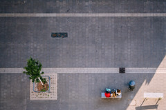 A Rest from Shopping ;) (freyavev) Tags: birdseyeview tree lines shoppingcenter geometry pavement perspective bench people stuttgart badenwrttemberg milaneo germany deutschland vsco urban shadow
