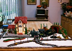 Gingerbread Train Depot! (ineedathis,The older I get the more fun I have....) Tags: christmas2006 gingerbreadhouse traindepot baking modeling miniatures cakedecorating gumpaste sugarcraft nikone5700 ps railroad kitchen bakersworkbench bucherblock flower window clementines winter maplewood granite stone pastamachine fun powerlines oldtrain tunnel trees trainstop bench people logs watertower traintracks roads cars railroadcrossing imagination yesteryear stopsign coal