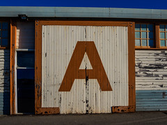 A Shed (aushiker) Tags: a ashed cityandarchitecture decay doorsandwindows door fremantle frenantleport goldenhourblue goldenhour harbours historical mu43 microfourthirds mirrorless olympusmzuikodigitaled1442mmf3556rii olympusomdem1 outdoor photography sheds signs wharf windows