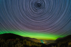 "Les aurores brillent et ""les toiles tournent"" (fredbeaupre) Tags: astrophotography auroraborealis blue canada color deepskyobject fall fog forest green landscape location longexposure manmade mountain nature nightscape northernlights photo quebec quebeccity season sky star startrail tewkesbury tree village widefield stonehamettewkesbury qubec ca"