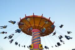 Navy Pier Swings (dhwani-j) Tags: navy pier chicago illinois boardwalk swings amusement park ride yellow red blue nikon d3200 sooc