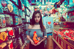 Chinatown Chicken (Jon Siegel) Tags: nikon d810 sigma 24mm 14 sigma24mmf14art 24mmf14 sigmaartlens woman girl beautiful redlipstick chicken cute funny crazy portrait evening night chinese chinatown singapore singaporean people sexy colorful experimental