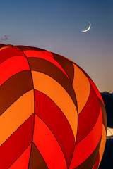 Night Glow and a Cresent Moon47: Vertical Crop (tltichy) Tags: usa albuquerque balloon balloons blue cresent dusk evening festival fiesta glow green hotairballoons international moon newmexico night nightglow orange outdoors red southwest travel twilight