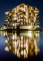 Het Waterhart (Kjeldvdh) Tags: building concrete mirror reflection double two architecture dark light water float lake pond street streetart structure streetlight brush blue purple orange yellow contrast bright licht wasser architektur gebaude vathorst amersfoort perspective wide long exposure portait nikon night niederlnde nightscape nikkor nacht clear dynamic europe white aqua kleur colorful outdoor winter cold sky serene vibrant house appartement saturated nederland manmade art kunst outdoors buiten kalt