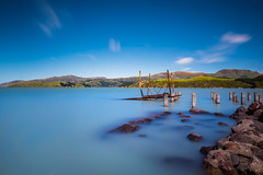Blues (Stefan Nikoloff) Tags: christchurch nikond810 lee thesuperstopper sharp focus rocks water seascape beach boulders ruins rust hills mountains clouds longexposure sea seaside harbour blue steel waterscape landscape sky beautiful interesting amazing colourful infocus