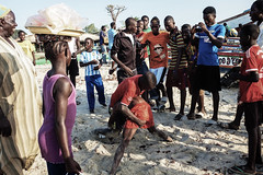 A little dust up... (Mike Foo) Tags: gambia africa market streetphotography candid fuji travel people fight watching wrestling