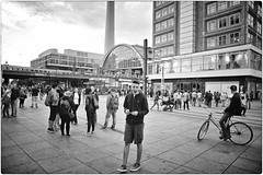 Modern Times (Steve Lundqvist) Tags: germany germania berlin berlino alexanderplatz platz square boy nikon nikkor 24mm blackandwhite bw urlo shout yell cry grido scream screaming shouting kid monochrome deutschland shorts sweatshirt hooded hood lacoste hairstyle people gente street streetwear streetphotography teenager teen train station bridge berliners berliner architecture bike biker building windows chimney smokestack stack torre ciminiera tower