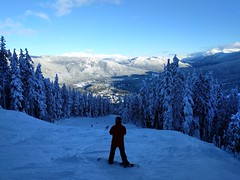 Downwards urge (Ruth and Dave) Tags: dave snowboarder whistler whistlerblackcomb whistlermountain skiresort piste bumps moguls trees valley view standing