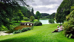 Relaxing at Stourhead (Beardy Vulcan) Tags: park bridge summer england people woman lake man river garden relax relaxing august stourhead wiltshire nationaltrust mere 2009 stourton riverstour thegardens thegardensa