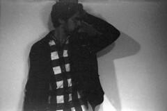 expired selfportrait #9 - cool (Joo Carmo) Tags: camera old boy shadow portrait blackandwhite white man black film face contrast analog self vintage photography adult minolta eagle expression misc grain lofi young maco hi himatic grainy expired matic minoltahimatic7s rokkor