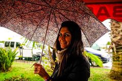 Chiaretta (gilderstern) Tags: street portrait people blackandwhite italy color girl smile umbrella photography liguria x100 santostefanoalmare