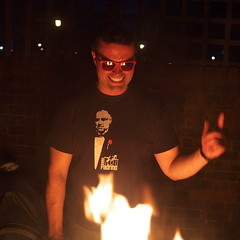 The Devil (Gary Kinsman) Tags: party london smile sunglasses night houseparty pose garden fire evening availablelight ambientlight evil posed bbq shades grin devil hackney clapton maniac highiso thedevil e5 2014 thegodfather ilpadrino fujix100 fujifilmfinepixx100
