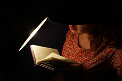 Day 36 (Esme on Plum Island) Tags: reading book lamplight hat femaleface lowlight lowlit werehere filmnoir moody