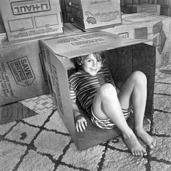 boy happily boxed in (Pejasar) Tags: bw boy cardboard box happy grandson play fun movingboxes barefoot child