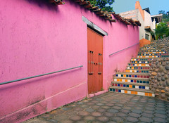 Bright walls with a tiled stairsway in Talpa, one of Mexico's Pueblos Magicos in the Pacific high sierras (albatz) Tags: sierramadre westcoast buildings talpa mexico pueblosmagicos pacific high sierra wall bright door pink stairs tiled stairway jalisco town