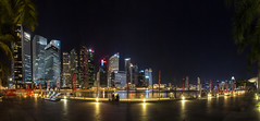 Singapore at night (diwan) Tags: asia southeastasia republicofsingapore republiksingapur   islandcountry citystate stadtstaat singapur olympicwalk architecture wolkenkratzer skyscraper skyline light nacht night outdoor langzeitbelichtung longexposures panoramix panorama stitch ptgui canoneos650d canon eos 2015 geotagged geo:lon=103856394 geo:lat=1280844