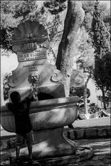 Nice, France (TheJonCrane) Tags: street travel boy urban blackandwhite paris france film fountain 35mm real outside outdoors nice cotedazur photojournalism popular 35mmphotography photojournalist nicefrance frenchriviera featured realpeople capturedmoments