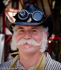 Steampunk Hat and Goggles II (Jim Frazier) Tags: costumes summer portrait people usa fashion festival wisconsin pose hair bristol glasses clothing cowboy eyecontact mechanical cosplay caps goggles victorian culture hats july beards posed fair whiskers equipment fantasy portraiture faire sideburns characters inventions facialhair machines mustache costuming gears wi renaissance bristolrenaissancefaire fayre edwardian q3 apparatus roles renaissancefair devices waxed steampunk kenosha v500 bristolrenaissancefair eyetoeye 2013 5000people ldjuly ©jimfraziercom adifferentpersona ld2013 20130700bristol 20130720bristol