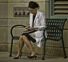 Doctor texting (Kevin Adams.1) Tags: smart fashion work bench notebook lunch concrete glasses sitting highheels break phone legs dr laptop seat working cellphone skirt pearls medical busy doctor heels medicine brunette knees emergency labcoat ankles calves texting bronsonhospital