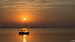 Sleeping on a sailboat at sunrise (BraCom (Bram)) Tags: trees sun holland reflection clouds sailboat sunrise canon bomen widescreen nederland thenetherlands silhouettes wolken 169 haringvliet zon soe zeilboot zuidholland goereeoverflakkee tiengemeten southholland zonsopkomst silhouetten canonef24105mm spigeling reflectsobsessions stadaantharingvliet bracom canoneos5dmkiii