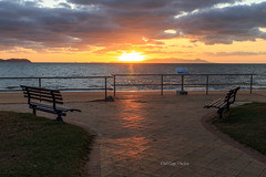 IMG_1132-1fw (Phil Copp) Tags: morning light beach water clouds sunrise bench seat rails townsville pallarenda