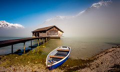 Colorful (Clickpix) Tags: travel blue house mountain lake fog boot austria see boat tirol sterreich reisen nebel haus berge blau tyrol vision:beach=067