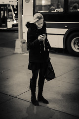 On the street, on the phone (Disappointed after dark) (DrAnthony88) Tags: life street new york usa station night subway square 50mm nikon phone unitedstates manhattan f14 g union nikkor afs on d700