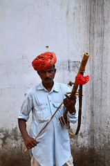 Musician in Pushkar (a.Muller) Tags: street city trip travel red vacation portrait people musician music india white holiday man color men colors geotagged photography photo nikon asia photos indian picture instrument pushkar rajasthan