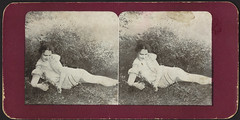 Woman lounging in tall grass (Boston Public Library) Tags: legs meadows bostonpubliclibrary bpl stereographs photomechanicalprints glamourphotographs