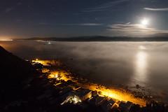 Sea fog lit by the rising moon (Brendon & Keryn) Tags: newzealand summer moon fog night wellington northisland southcoast