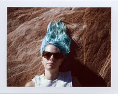 Blue Hair Red Rocks (T-Terror) Tags: polaroid autumnpolaroidweek2016 day4 roidweek2016 roidweek polaroidweek instant color roadtrip fujifp100c poloroidland350 landcamera valleyoffire nevada nevadastatepark rocks woman girl blue bluehair glasses