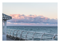 23/31: Over the edge (judi may - more off than on) Tags: october2016amonthin31pictures norfolk cromerpier cromer sea water pier railings fence hut clouds sky canon7d
