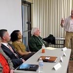 Gary Wszalek, Head Undergraduate Advisor, introduces the alumni panelists: L-R: Susan Keller, The Honorable Robert Villa, Alicia Canario, Gregory Kyrouac