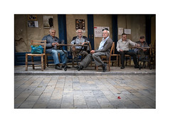 untitled (chiara baragatti) Tags: people greek crete street bar raki relax moment colours traditional light chair table drink friendship