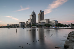 Amsterdam Towers (McQuaide Photography) Tags: amsterdam noordholland northholland netherlands nederland holland dutch europe sony a7rii ilce7rm2 alpha mirrorless 1635mm sonyzeiss zeiss variotessar fullframe mcquaidephotography adobe photoshop lightroom tripod manfrotto light licht availablelight longexposure stad city urban lowlight outdoor outside architecture skyline building gebouw wideangle wideanglelens groothoek modern modernarchitecture omval tower toren skyscraper water reflection ndfilter bwfilters nd18 6stop neutraldensity nd rembrandttoren rembrandttower modernism waterfront river riverside amstel amstelriver