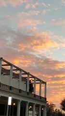 Sunset over the Getty (colonelchi) Tags: camera phone smart la losangeles smartphone getty villa museum antiquities gettyvilla gettymuseum romanvilla malibu santamonica pacificpalisades greek roman ancient grekoroman history duplication replication landmark famous sunset cloud samsung galaxy edge samsunggalaxyedge balcony light lamp pillar sky courtyard