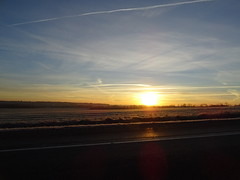 Fire within the layers of soft clouds (Cheerful Photos) Tags: outdoor sun light morning sky clouds winter horizon