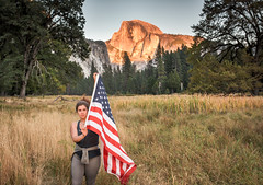 There's Still Plenty to Be Grateful for in America (Geoff Livingston) Tags: fypx girl woman america americanflag yosemite halfdome field sunset mountain