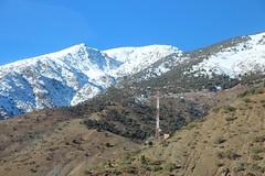 Crossing the Atlas Mountains (John Englart (Takver)) Tags: morocco atlasmountains mountains communications tower snow