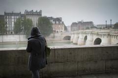 Paris (fredcan) Tags: street city autumn woman paris france home wet rain silhouette seine standing river back europe rainyday streetscene hood pontneuf riverbanks centralparis quaidegesvres fredcan
