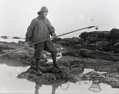 H00471  Amongst the rock pools c.1890 (East Sussex Libraries Historical Photos) Tags: sea man seaweed net costume fisherman sand rocks library victorian rod hastings 1890 rockpools glassplatenegative oilskins georgewoodscollection