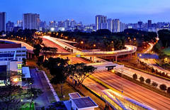 Highways and Byways I (Rebecca Ang) Tags: lighting city light urban lines buildings twilight highway singapore apartments cityscape curves flats lighttrails bluehour hdb traffictrails thebluehour cte urbanarchitecture centralexpressway housinganddevelopmentboard rebeccaang
