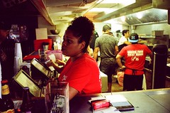 Burger Joint (Henricus) Tags: cashier burgers provia800 pushed1 leica 352